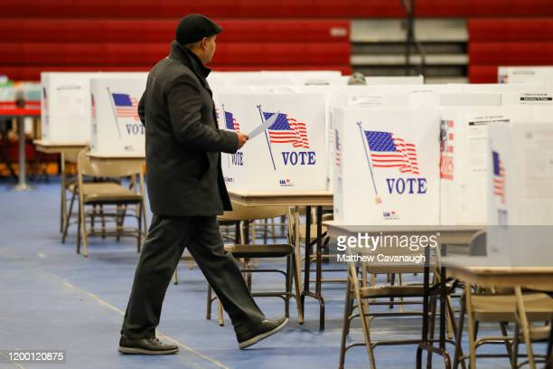 A voter walk to the voting booth at Bedford High School during the New Hampshire primary on February 11 2020 in Bedford New Hampshire