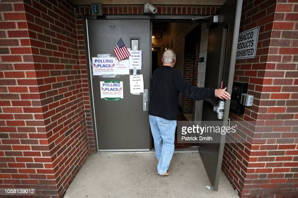 A voter walks into a polling station on Election Day on November 6 2018 in Charleston West Virginia West Virginia Republican Senate Candidate Patrick...