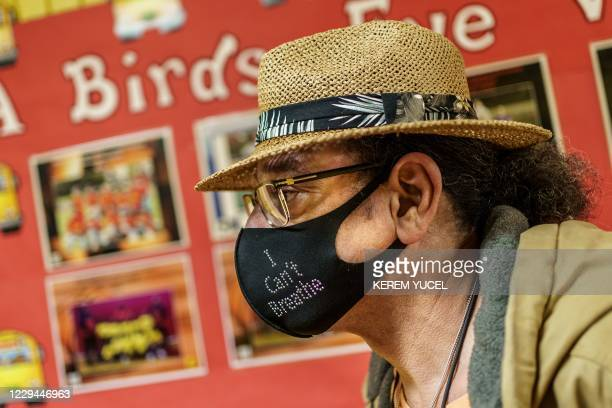 """Voter wearing a mask saying """"I can't Breathe"""" is seen during the US presidential election at a polling place on election day in Minneapolis,..."""