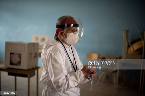 Voter wearing protective mask casts a ballot at a polling station during the runoff of the presidential elections in Quito, Ecuador, on Sunday, April...