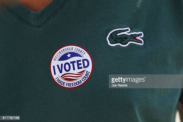 A voter wears a I Voted sticker as he leaves a polling station at the Hillsbourgh County Supervisor of Elections office after early voting on October...