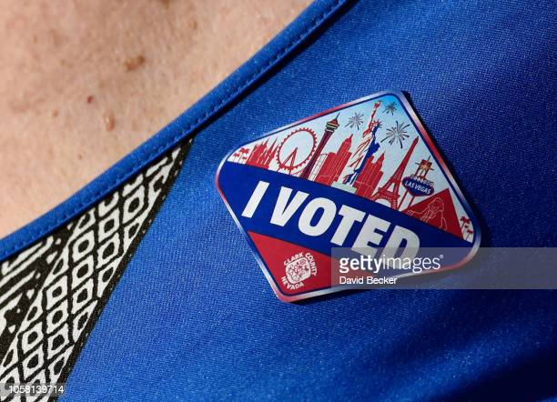 A voter wears a Las Vegas Stripthemed 'I Voted' sticker after casting her ballot on November 6 2018 in Las Vegas Nevada Turnout is expected to be...