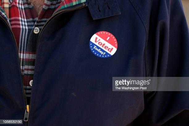 A voter wears a sticker outside Kirkwood Community Center in Kirkwood MO on November 6 2018