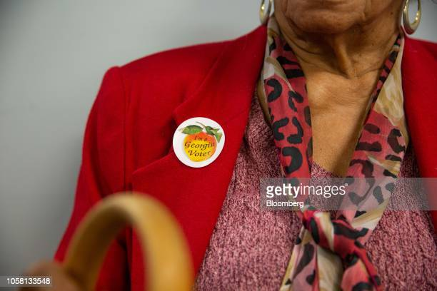 A voter wears a sticker that reads I'm a Georgia Voter at a polling station in Atlanta Georgia US on Tuesday Nov 6 2018 Today's midterm elections...