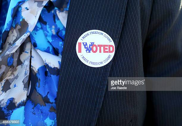 A voter wears an I Voted sticker after casting her ballot at The Coliseum where a polling station is setup on November 4 2014 in St Petersburg United...