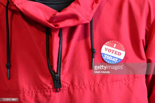 """Voter wears an """"I VOTED TODAY"""" sticker after casting his ballot at the Philadelphia City Hall satellite polling station on October 27, 2020 in..."""