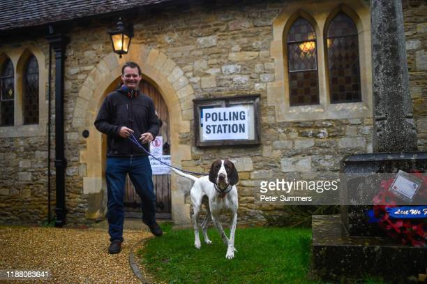 A voter with a dog leaves after casting his ballot paper at a polling station inside a church on December 12 2019 near Oxford United Kingdom The...