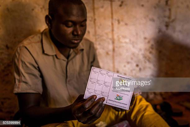 Voter with his electoral card in Riad district of Niamey Niger on February 16th 2016