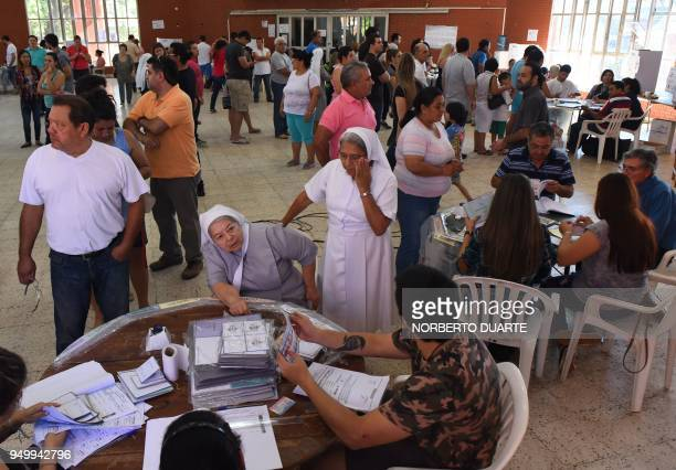 Voters are seen at a polling station during general elections in Asuncion on April 22 2018 Opinion polls give Mario Abdo Benitez of the ruling...