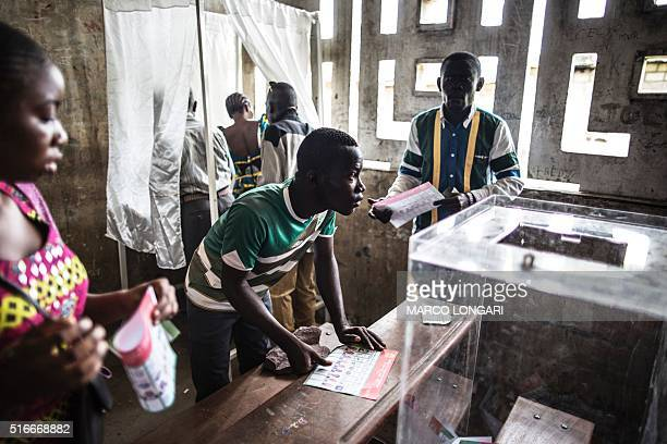 TOPSHOT Voters are seen at a polling station during presidential elections in Makelele Brazzaville on March 20 2016 Congo began voting on March 20...