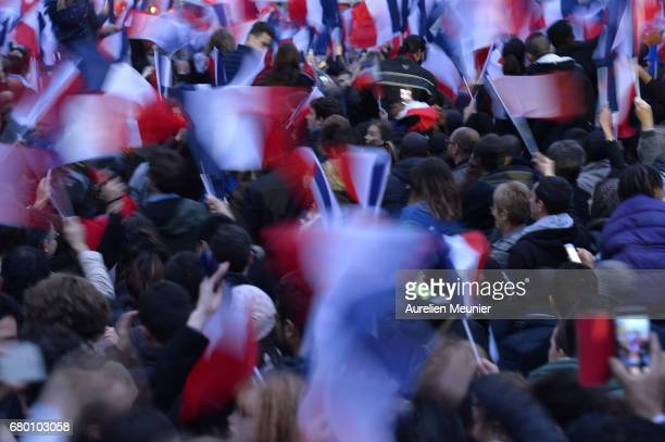 Voters are waving flags during Emmanuel Macron speech as he celebrates his Presidential election victory At Le Louvre In Paris on May 7 2017 in Paris...