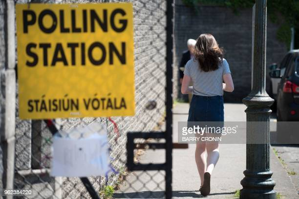 Voters arrive and leave St Patrick's Boys National School polling station in Drumcondra Dublin to vote in the Irish referendum on liberalising...