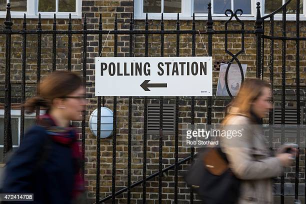 Voters arrive at a polling station in the Borough of Islington on May 7 2015 in London United Kingdom The United Kingdom has gone to the polls to...