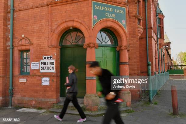 Voters arrive at Salford Lads Club on Coronation Street in Salford to cast their votes in the Manchester Mayoral election on May 4, 2017 in...