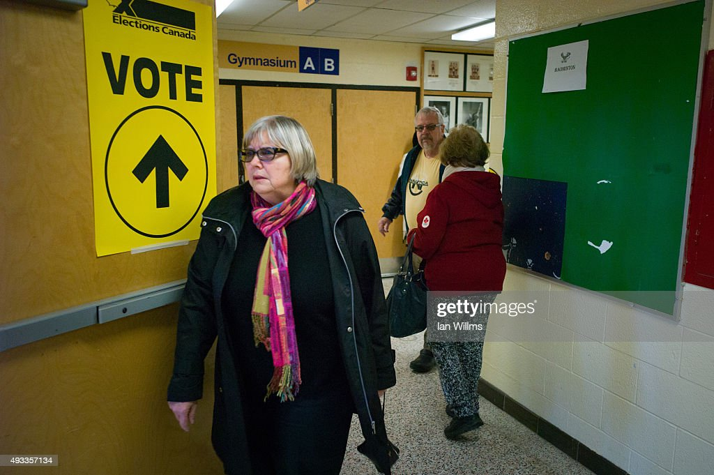 Voters arrive at the polling station at Glenforest Secondary School during the 42nd Canadian general election October 19, 2015 in Mississauga, Canada. Canadians went to the polls to decide whether to continue 10 years of conservative rule with current Prime Minister Stephen Harper or go with Justin Trudeau and a new Liberal Party.