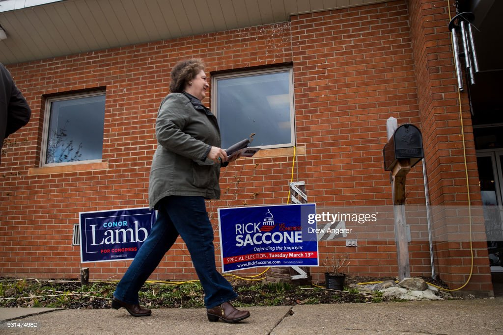 Voters arrive at the polling station at Our Lady of Victory Church March 13, 2018 in Carnegie, Pennsylvania. Voters head to the polls today as Lamb is running in a tight race for the vacated seat of Rep. Tim Murphy (R-PA) against Republican candidate Rick Saccone.