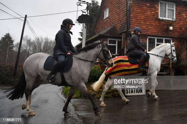 Voters arrive on horses at The Rock Inn pub, being used as a polling station in Chiddingstone Hoath, near Edenbridge, south-east England on December...