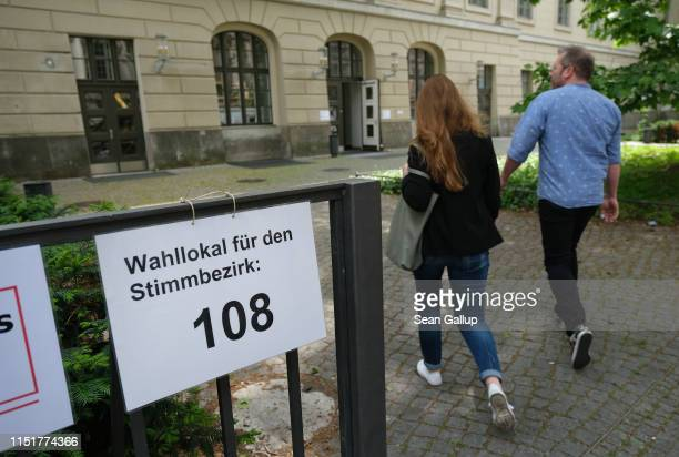 Voters arrive to cast their ballot at a polling station during European parliamentary elections on May 26 2019 in Berlin Germany Today is the last...