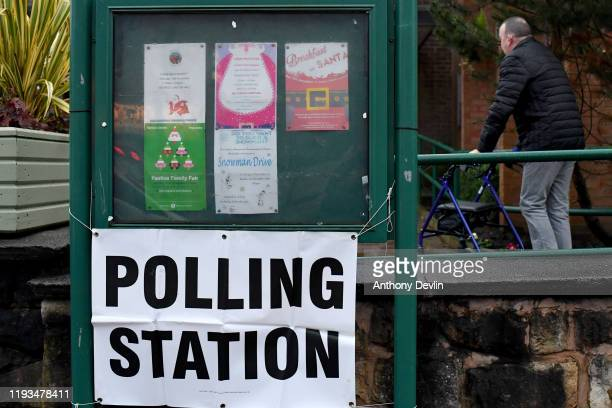 Voters arrive to cast their ballots at George Lawton Hall in Mossley on December 12, 2019 in Greater Manchester, England. The current Conservative...