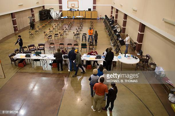 Voters arrive to cast their ballots in the Super Tuesday primary at the Grace United Methodist Church on March 1 2016 in Conway Arkansas Americans...