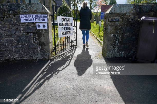 Voters arrive to cast their vote at a polling station in St Michael's church in the the village of Brynford, North Wales on May 06, 2021 in Holywell...