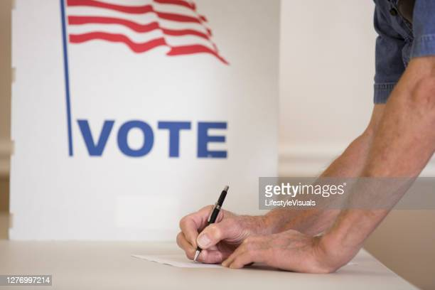 voters at polling place - republican party stock pictures, royalty-free photos & images