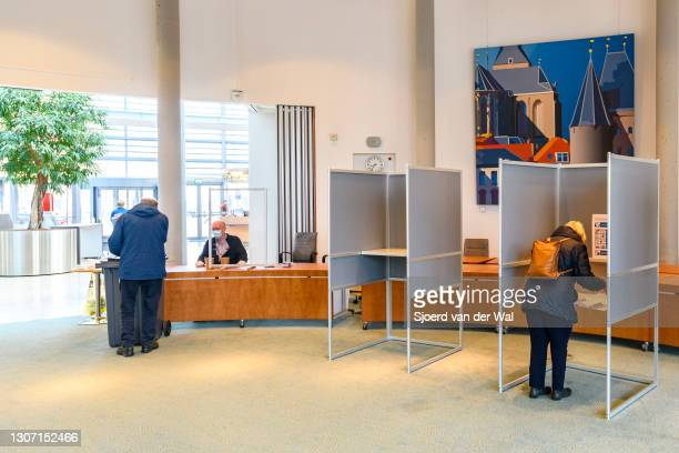 Voters at the polling station inside the Kampen town hall for the general elections for the House of Representatives - Tweede Kamer - for the Dutch...