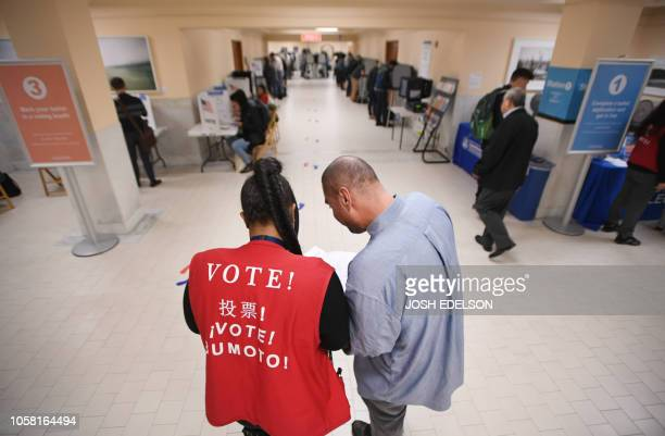 Voters begin casting their ballots at City Hall in San Francisco, California on November 6, 2018. - Americans started voting Tuesday in critical...