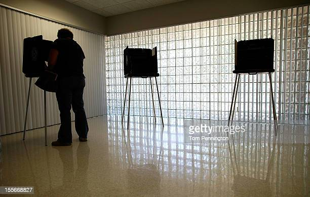 A voters cast a ballot on November 6 2012 in Mansfield Texas Americans across the country participate in Election Day as President Barack Obama and...