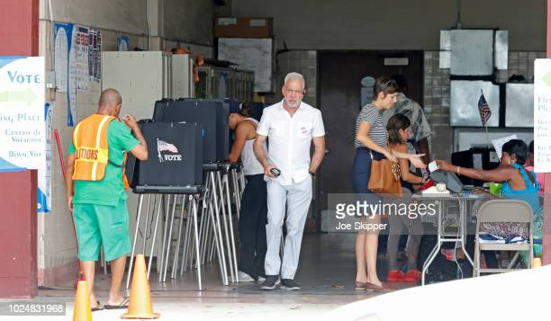 Voters cast ballots at a downtown polling place on August 28 2018 in Miami United States The state of Florida has primary day elections as voters...