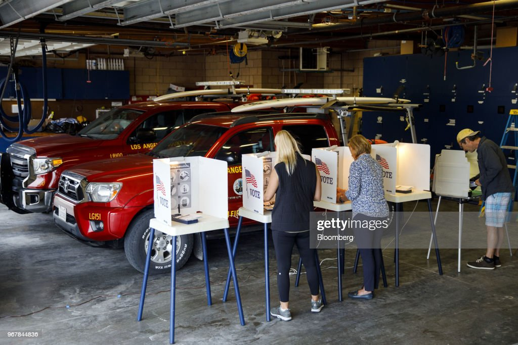 Voters cast ballots at a polling location inside a lifeguard station in Hermosa Beach, California, U.S., on Tuesday, June 5, 2018. Democrats are facing a potentially destructive California primary vote Tuesday for an unlikely reason: too many viable candidates are running for the same U.S. House seats. Photographer: Patrick T. Fallon/Bloomberg via Getty Images