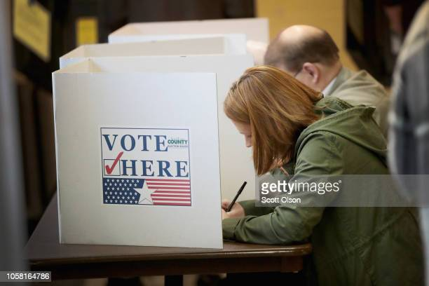 Voters cast ballots at a polling place on November 6, 2018 in Kirkwood, Missouri. Voters across the country are casting ballots in a midterm election...