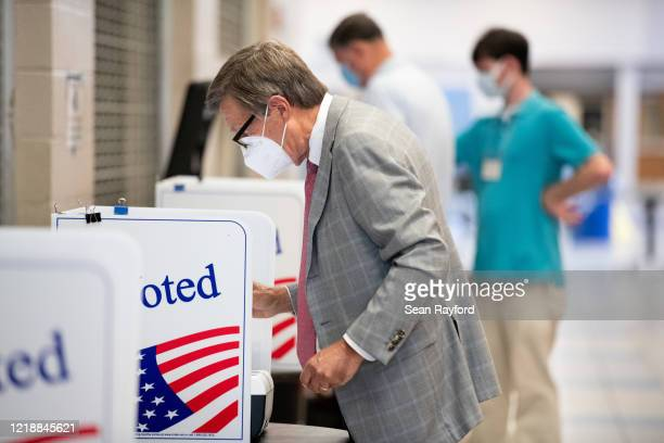 Voters cast ballots at a polling station at Dreher High School on June 9, 2020 in Columbia, South Carolina. Georgia, Nevada, North Dakota, South...