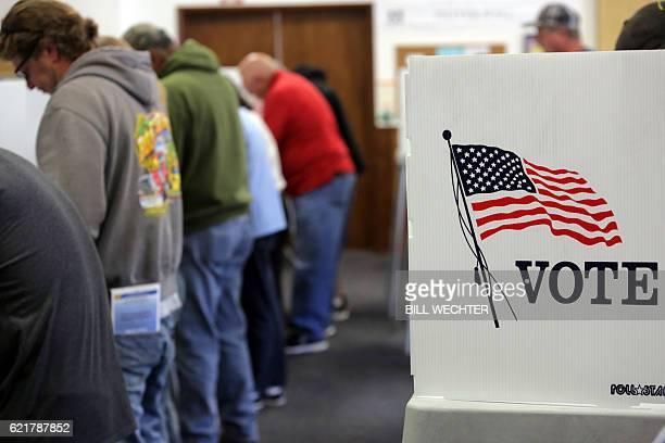 Voters cast ballots at a polling station at the Big Bear Lake Methodist Church in Big Bear California November 8 2016 / AFP / Bill Wechter