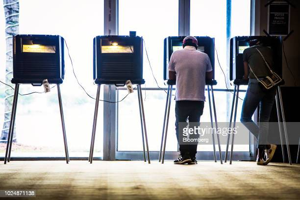 Voters cast ballots at a polling station in Doral Florida US on Tuesday Aug 28 2018 The Senate contest in Florida is all but set between threeterm...
