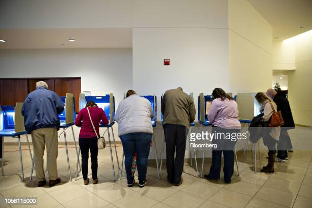 Voters cast ballots at a polling station in Wauwatosa, Wisconsin, U.S., on on Tuesday, Nov. 6, 2018. The most expensive midterm campaign in U.S....