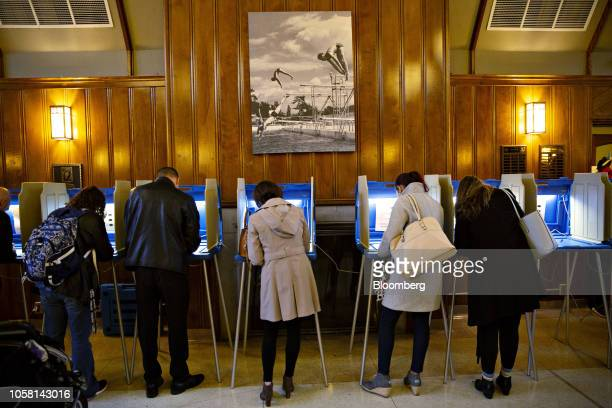 Voters cast ballots at a polling station inside Hoyt Park Grand Hall in Wauwatosa, Wisconsin, U.S., on Tuesday, Nov. 6, 2018. More than 34 million...