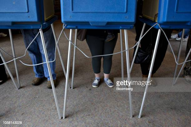 Voters cast ballots at a polling station inside the clubhouse at Currie Park Golf Course in Wauwatosa, Wisconsin, U.S., on Tuesday, Nov. 6, 2018....