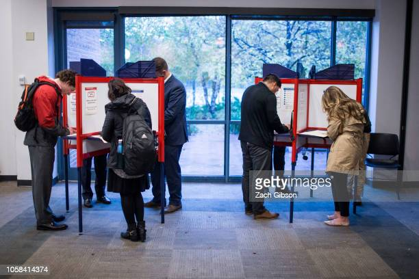 Voters cast ballots at the Arlington Central Library during the 2018 midterm election on November 6 2018 in Arlington VA Today millions of Americans...