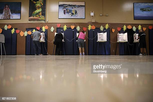 Voters cast ballots at the Brooklyn Avenue Elementary School in Los Angeles California US on Tuesday Nov 8 2016 Fiftyone percent of voters nationally...