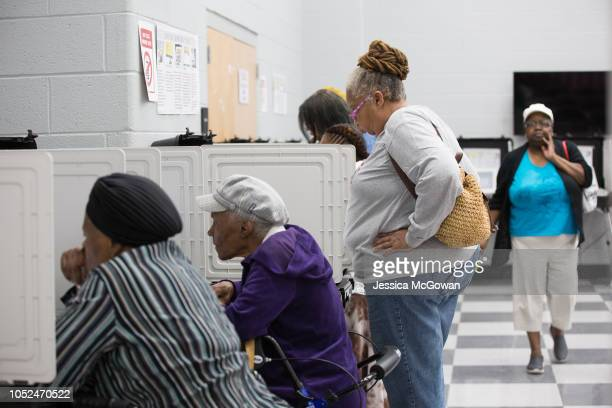 Voters cast ballots during the early voting period at CT Martin Natatorium and Recreation Center on October 18 2018 in Atlanta Georgia Early voting...