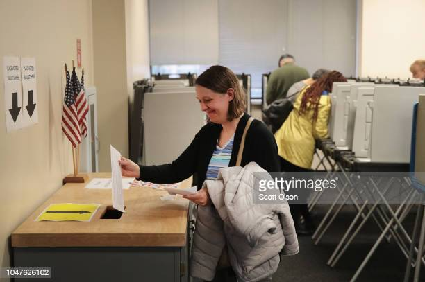 Voters cast ballots for the midterm elections at the Polk County Election Office on October 8 2018 in Des Moines IowaToday was the first day of early...