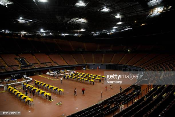 Voters cast ballots on electronic Voting Solutions for All People ballot marking machines at an early voting polling location at The Forum arena for...