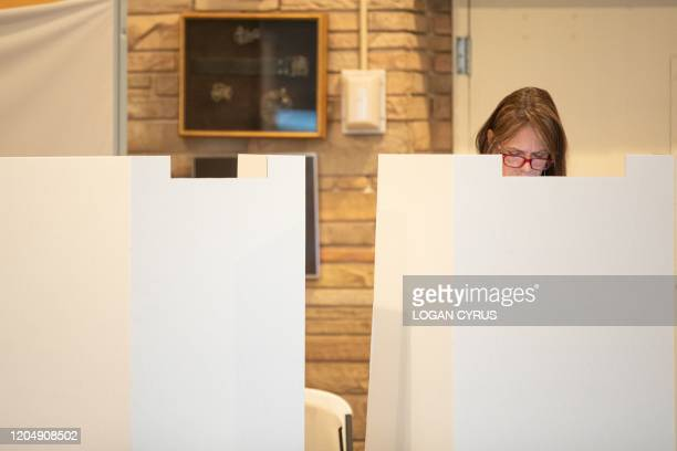 Voters cast their ballot at Myers Park High School during the North Carolina primary on Super Tuesday in Charlotte, North Carolina on March 3, 2020....