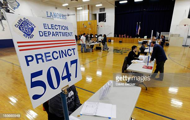 Voters cast their ballot at the polling station at John Fremont Middle School on November 6 2012 in Las Vegas Nevada Voting is underway in the...