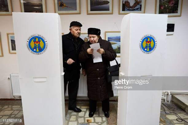 Voters cast their ballot during the parliamentary elections on February 24 2019 in Chisinau Moldova