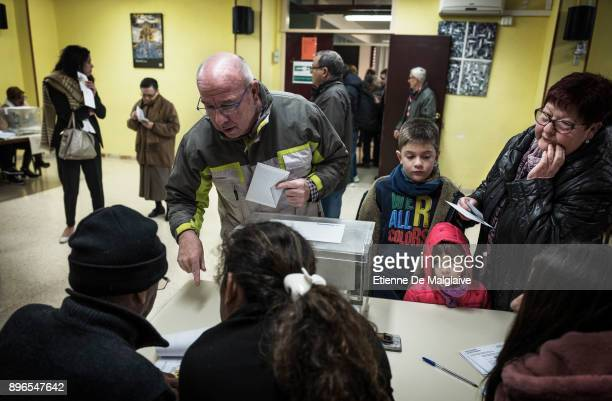 Voters cast their ballot for the Catalan regional election at a school polling station on December 21 2017 in Badalona SpainCatalan voters are...