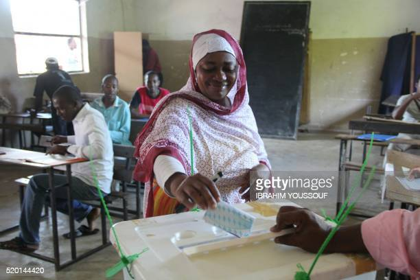 Voters cast their ballot in Mitsoudjé on April 10 2016 during the second round of Presidential elections in Comoros Voters head to the polls in the...