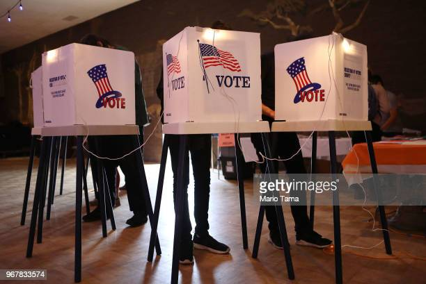 Voters cast their ballots at a Masonic Lodge on June 5, 2018 in Los Angeles, California. California could play a determining role in upsetting...