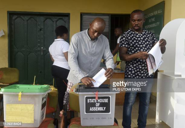 Voters cast their ballots at a polling station in Port Harcourt Rivers State on March 9 during voting to elect governors and lawmakers in 29 of the...